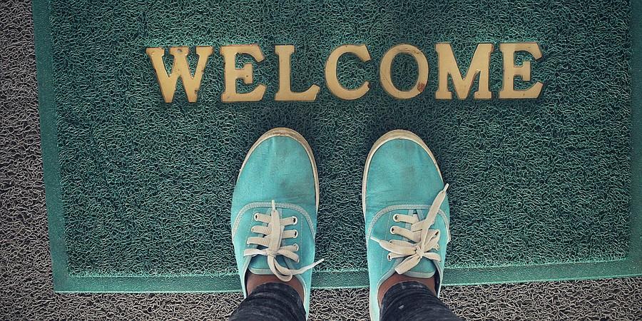 saubere Fußmatte, Schuhe des Kunden